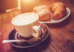 Croissants and a cup of coffee at a business networking event